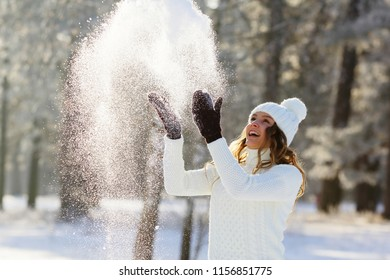 Winter girl throws snow up, christmas holiday