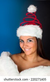 Winter girl wearing a funny red christmas santa hat