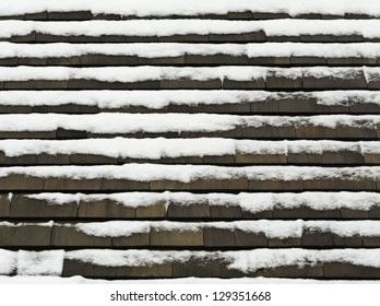 Winter at a glance: Roof with cedar shakes and snow