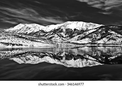 Winter glimpse of Lake Campotosto frozen in black and white