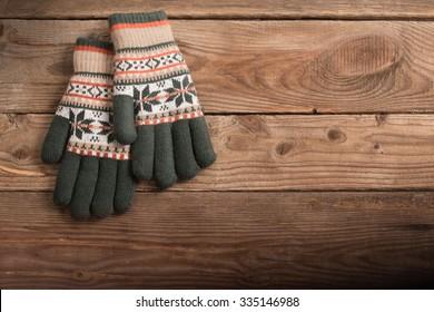 winter gloves on wooden background