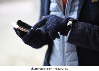 winter gloves wearing by handsome man - phone, mobile, iphone