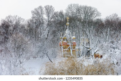 Winter in Gomel. Belarus. View from the pedestrian bridge to the chapel, tomb and cathedral of Peter and Paul. Gomel Palace and Park Ensemble.