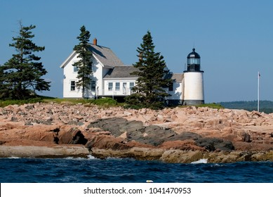 Winter Harbor lighthouse is an island beacon in down east Maine, on a summer day near Acadia National Park.