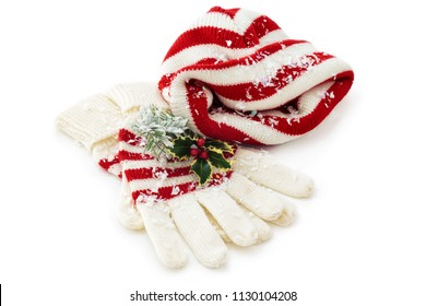 Winter hat and gloves isolated on white.