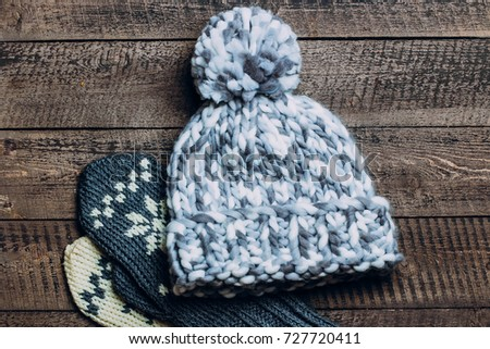 63b5c5c33394b Winter Hat and Gloves on Wooden Background. Seasonal warm clothes