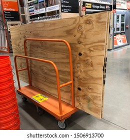 WINTER HAVEN, FL/USA - SEPT 2019: Plywood queued for purchase at Home Depot before the expected impacts of Hurricane Dorian. The family buying this hoped it wasn't needed, but wanted to prepare.