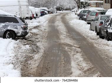 Winter. Heavy snowfall in the city, snowy icy roads, snowy sidewalks, broken broken branches, uncleaned streets