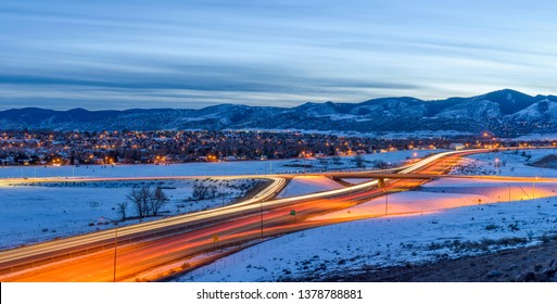 Winter Highway - A panoramic overview of U.S. Highway 285 winding at the foothill of Front Range of Rocky Mountains on a stormy winter evening. Southwest of Denver, Colorado, USA.