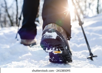 Winter hiking.  Lens flare, shallow depth of field.