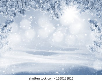 Winter holiday background. Christmas landscape with snowdrifts and pine branches in the frost. Background for design and cards.