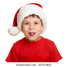 winter holiday christmas concept - boy in santa hat portrait on white show tongue