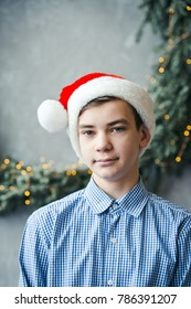 winter holiday christmas concept - boy in santa hat