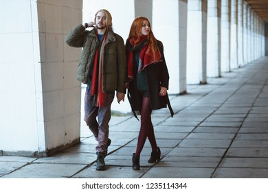 Winter holiday, dating, urban fashion and relationship concept. Stylish hipsters couple walking in the winter street.
