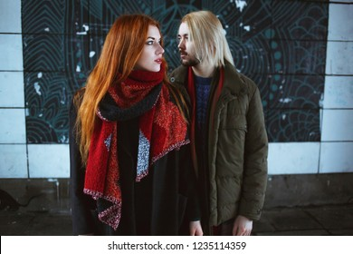 Winter holiday, dating, urban fashion and relationship concept. Stylish hipsters couple standing in the winter street.