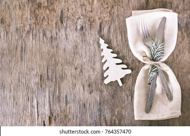 Winter holiday dinner plate decoration on old wood background. table set with a winter, Christmas decoration. Winter holiday theme.  Happy New Year. Space for text.