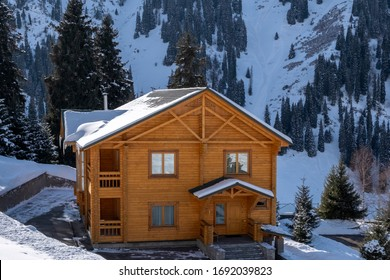 Winter holiday house in mountains. Mountain vacation houses at ski resort. Winter wonderland.