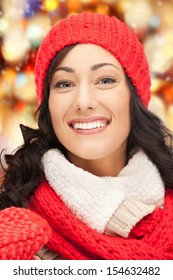 winter, holidays, christmas concept - beautiful woman in hat, muffler and mittens