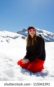 Winter holidays, winter fun- portrait of young snowboarder girl