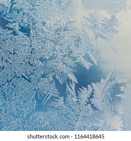 Winter Holidays Season Fantasy World Concept: Macro Image Of A Blue Frosty Window Glass Natural Ice Patterns With Copy Space