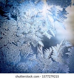 Winter Holidays Season Fantasy World Concept: Colourful Macro Image Of A Frosty Window Glass Natural Ice Patterns With Copy Space
