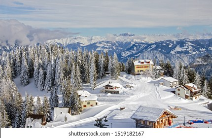 Winter holidays in a ski resort, mountain vacation, ski resort of Bad Ragaz in Switzerland in winter against the backdrop of ski slopes, snow-capped mountains and blue sky with clouds