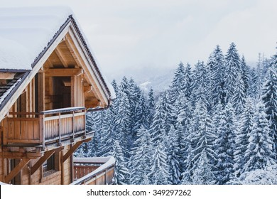 winter holidays, ski vacations background, wooden house under snow in the Alps