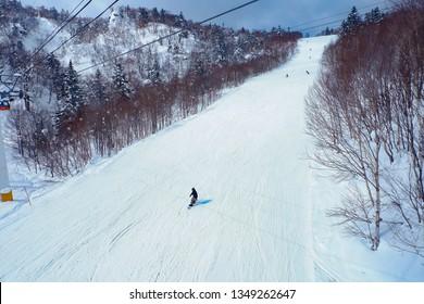 Winter holidays skiing at Sapporo Kokusai, Hokkaido, Japan.