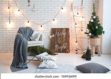 Winter home decor. Christmas tree in loft interior against brick wall.