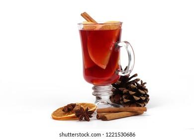 Winter hot drink - christmas tea or mulled wine - glass cup with a orange and christmas tea or mulled wine