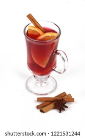 Winter hot drink with spices isolated on white background - christmas tea or mulled wine