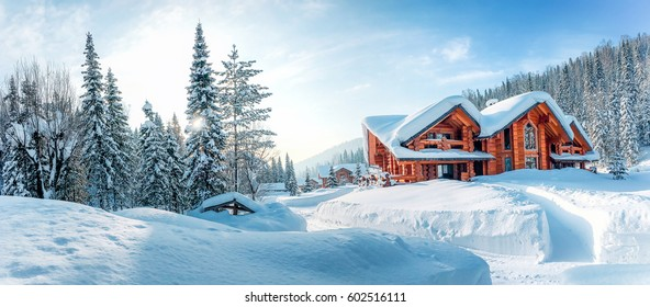 Winter house on winter snowy panoramic landscape