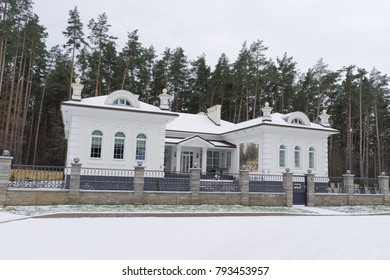 Winter house in the pine forest
