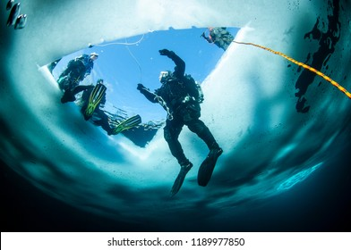 Winter ice diving underwater in a quarry in Canada