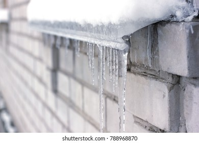 Winter icicles formed of melting snow