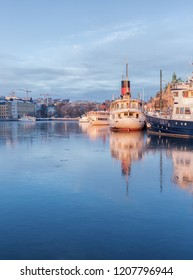 Winter image from Stockholm with ships reflecting in ice.