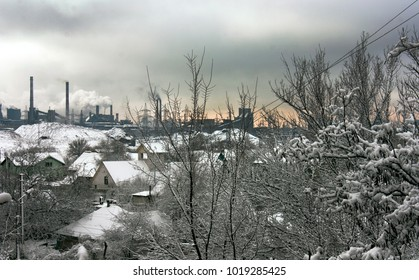 Winter industrial landscape, roof home in the snow, gray sky