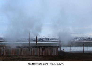Winter industrial scene with steam rising smokestacks