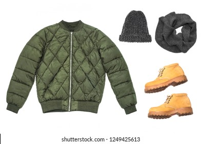 Winter jacket green, yellow boots with a tractor sole, gray woolen hat and scarf on a white background. Flat lay