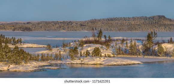 Winter Lake Ladoga. Open water is smoking from frost. On this day it was -25. The Republic of Karelia. Ladoga lake. End of January, 2018.