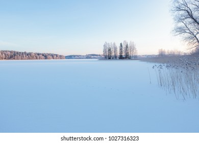 Winter lake scenery in finland at evening