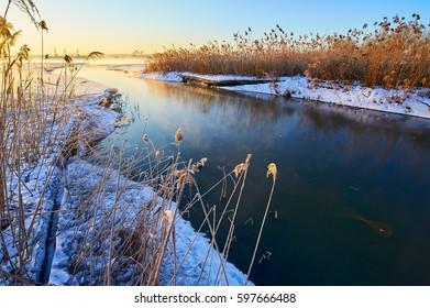 Winter lake sunrise scenery.