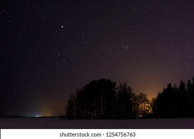 Winter lake view under the starry sky.