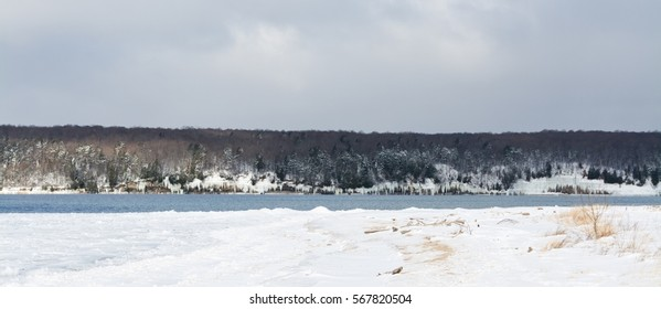 A winter lakeshore covered with snow.