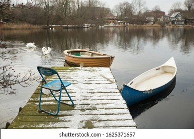 Winter Lakeside Landscape With Boat