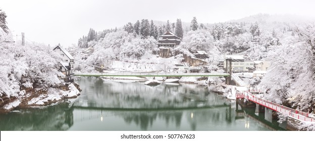 Winter Landcape with lake and village in Japan panorama