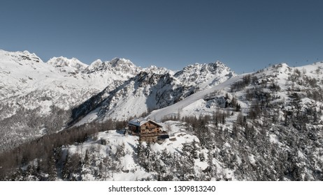 Winter landscape, alpine refuge and forest covered with snow.  Italian Alps, holidays in mountain