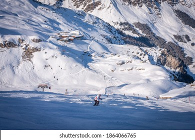 Winter landscape in the Alps. chalet house in Mayrhofen sports region in the Zillertal. Ski slopes in the background of mountains. Skiers descend a difficult black slope - Shutterstock ID 1864066765