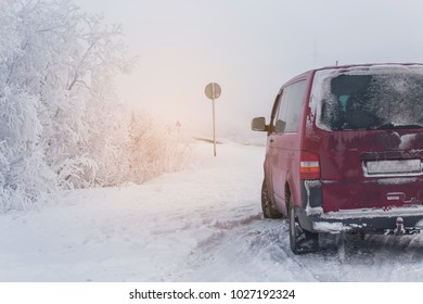 Winter landscape and car in snow.
