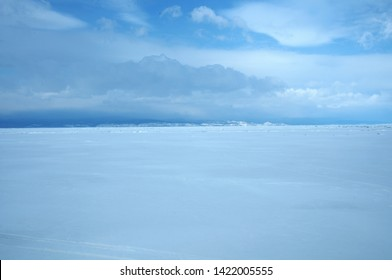winter landscape with clear sky and clowds